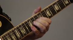 Playing Guitar - Tight Shot - Fingers on Fretboard Stock Footage