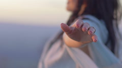 Young woman in meditation opens her arms to the sky: relaxation, spirituality Stock Footage