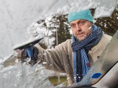 Male and ice scraper Stock Photos