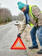 male and warning triangle - stock photo