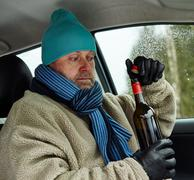 driver and wine bottle - stock photo