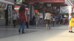 Indoor movement, people walk in huge hall, train station place, transportation Stock Footage