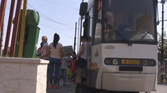 Streetcar in station, commuters go in and out of vehicle, modern tram in town Stock Footage
