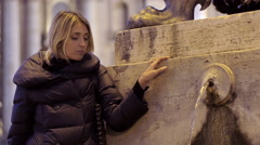 sad woman in Rome near a fountain in St. Peter square: sadness, depression - stock footage