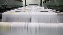 Newspaper Press, Fast moving paper on a roll in a printing factory - stock footage