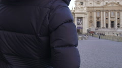 Young cute woman making photos with tablet to St. Peter Church in Rome Stock Footage