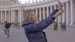 Cute woman using tablet computer to make photos to St. Peter Cathedral in Rome Stock Footage