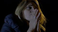 Lonely sad woman deep in prayer during the night: good seeking, desperation Stock Footage