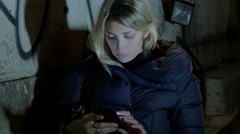 Young woman using smart phone touch screen in the night: beautiful blonde woman Stock Footage
