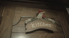 Chicken decoration on the wooden door slow motion Stock Footage
