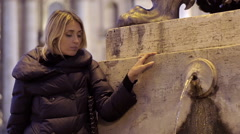 Sad woman in Rome near a fountain in St. Peter square: sadness, depression Stock Footage