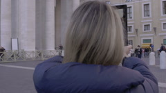 Young woman is making photos to St. Peter church with tablet pc: tourism in Rome Stock Footage