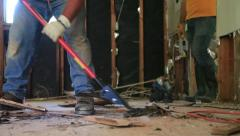 Tearing - Scraping - Out Floor - Trucking Shot Stock Footage