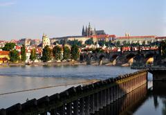 Charles bridge and Saint Vitus cathedral in Prague Stock Photos