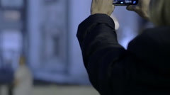 Stock Video Footage of young tourist makes night's photos to St. Peter Church in Rome with smart phone