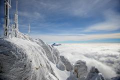 frost covered antennas on top of the alps - stock photo