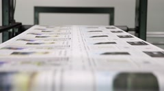 Newspaper Press - Fast moving print in factory Stock Footage