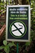 Smoke free environment sign in the forest, Monteverde, Costa Rica Stock Photos