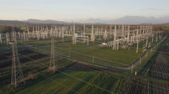 Aerial - Electrical energy facility at sunset - stock footage