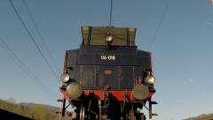 Rail track POV - Undercarriage of moving locomotive, slow motion - stock footage