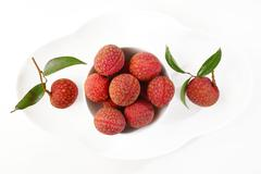 Lychees bunch on a plate Stock Photos
