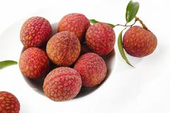 lychees in white bowl - stock photo