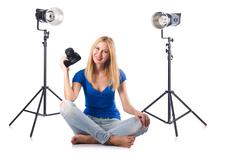 Stock Photo of Woman with camera isolated on the white