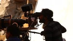 Silhouette of camera man Stock Footage
