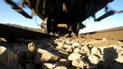 Rail track POV - Undercarriage of moving train, slow motion Stock Footage