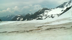 Thermal Blankets protect from global warming, Austrian Alps snow field, zoom in Stock Footage
