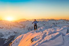 Lone climber on the summit Stock Photos