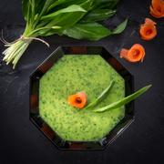 Bear allium soup with smoking salmon Stock Photos
