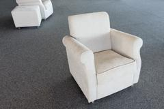 Stock Photo of white second-hand chair in furniture warehouse