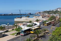 Busses and construction activities at the harbor of madeira Stock Photos