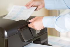 Stock Photo of Man making a photocopy