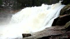 Water is falling into foamy pond below. High cascade of rystal freeze water - stock footage