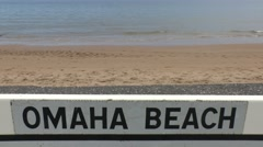 Stock Video Footage of Road sign on Omaha Beach between Vierville and St Laurent, Normandy, France.
