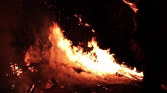 Person throws object into slow motion bonfire. - stock footage