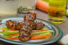 sticky teriyaki chicken skewers with crunchy slaw - stock photo