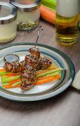sticky teriyaki chicken skewers with crunchy slaw - stock photo