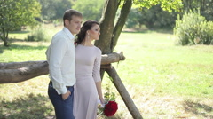 Newly married couple standing in the park Stock Footage
