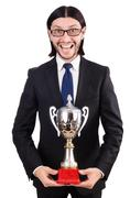 Stock Photo of Businessman awarded with prize cup isolated on white