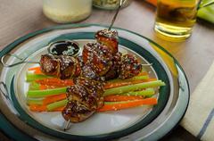 Stock Photo of sticky teriyaki chicken skewers with crunchy slaw