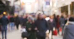 Crowd of anonymous people walking on busy Dublin street - stock footage