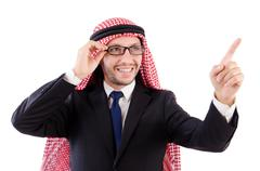 Arab man in specs pressing virtual buttons isolated on white - stock photo