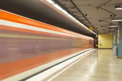Metro station with train in motion Stock Photos