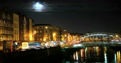 Night view of famous Ha'Penny Bridge in Dublin, Ireland Stock Footage
