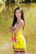 Smiling asian american woman outdoor water background Stock Photos