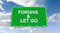 Forgive and let go sign against blue sky - stock footage