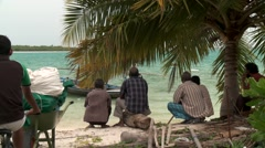 Villagers await fishermen in the Maldives Stock Footage